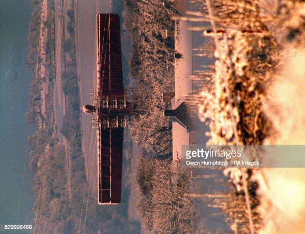 The Angel of the North gets its first covering of snow and glimmers in the rising winter sun today after 45 inches of snow fell during the night...