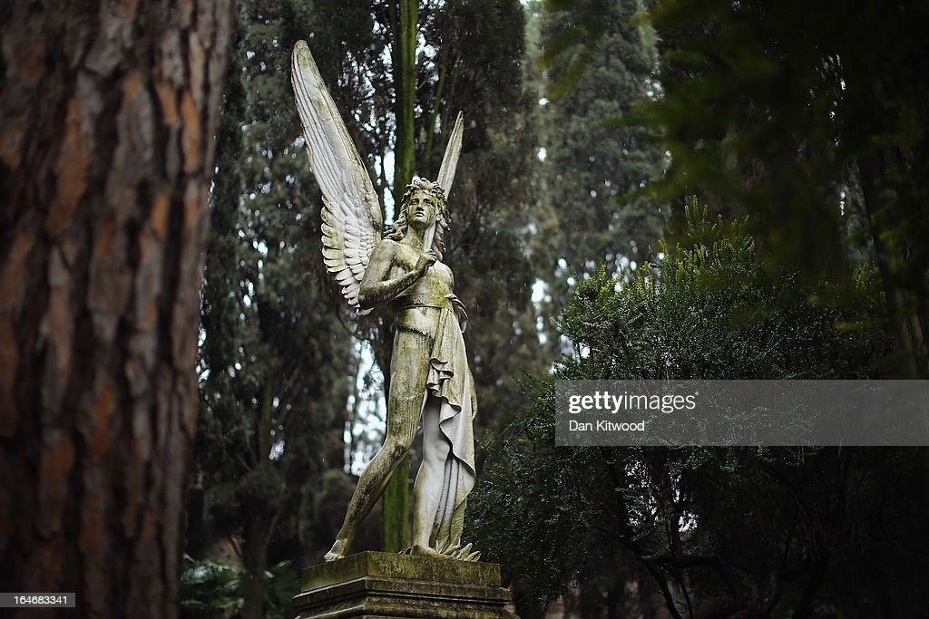 The 'Angel of the Resurrection' for prominent American sculptor Franklin Simmons, and his wife Ella, stands in Rome's 'Non Catholic Cemetery' on March 26, 2013 in Rome, Italy. Rome's Non-Catholic Cemetery contains one of the highest densities of famous and important graves anywhere in the world including John Keats, one of England's most famous poets, who died early in 1820 of tuberculosis aged 25, after travelling to Italy in search of a better climate to help cure him of the disease. As well as being the final resting-place of the poets Percy Shelley and John Keats, it is also home to graves of many other painters, sculptors and authors who died in Rome. The cemetery which began it's use in 1730 continues today, containing graves of Orthodox Christians, Jews, Muslims and other non-Christians, and is one of the oldest burial grounds in Europe.