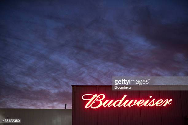 The AnheuserBusch Budweiser logo is displayed on the side of the Brewers Distributing Co warehouse in Peoria Illinois US on Thursday Oct 30 2014...