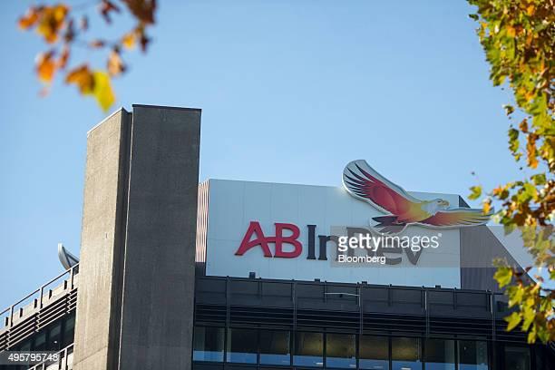 The AnheuserBusch InBev NV logo sits on the exterior of the Beck's brewery in Bremen Germany on Wednesday Nov 4 2015 UK Regulators gave AB InBev yet...