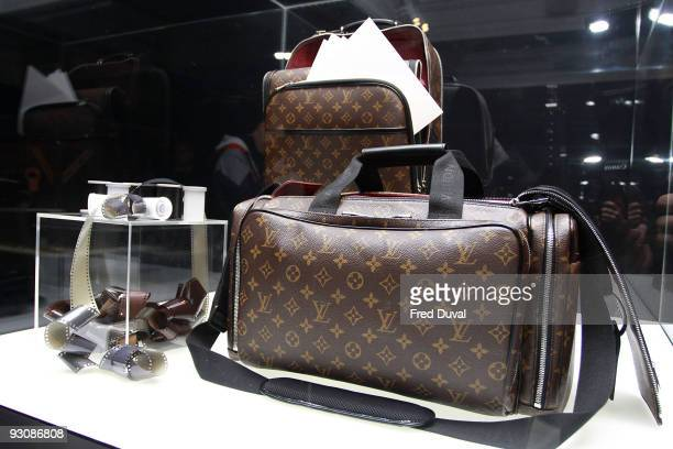 The Annie Leibowitz limited edition Louis Vuitton monogram nomadic photographer's bag is displayed at Sotheby's on November 16 2009 in London England...