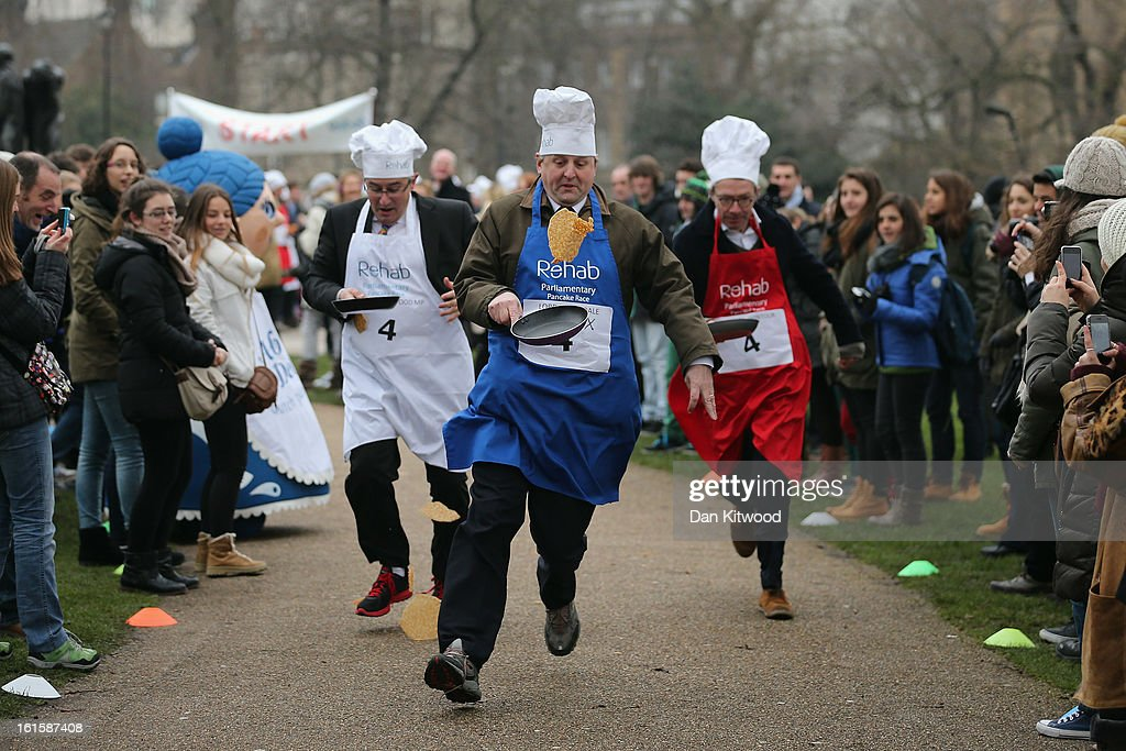 The annual Parliamentary Pancake Race takes place in front of the Houses of Parliament on Shrove Tuesday on February 12, 2013 in London, England. Now in it's 16th year, the annual Pancake Race, which raises money for the charity Rehab, sees teams of politicians and journalists racing in a circuit whilst tossing pancakes in frying pans. The team of MPs won this year's event.
