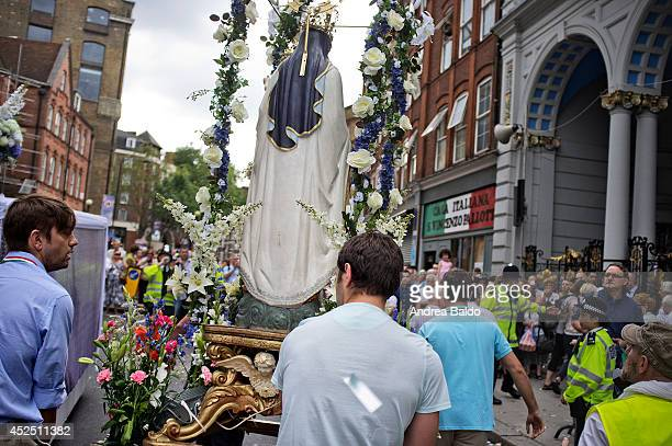 The annual procession of Our Lady of Mount Carmel the first Roman Catholic event on English streets for 349 years when it was allowed by Queen...