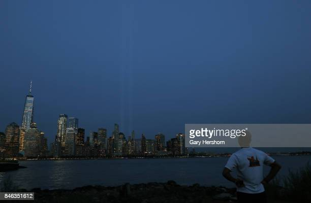 The annual Tribute in Light appears over lower Manhattan at sunset in New York City on September 11 2017 as seen from Jersey City New Jersey