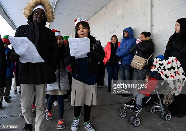 The Annunciation Catholic School choir entertains the crowd gathered for the 86th annual Denver Santa Claus Shop at the old Kmart store near Evans...