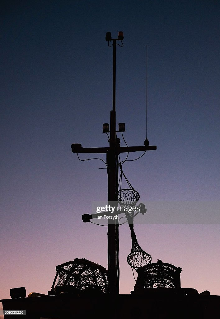 The antenna on a fishing boat is seen against the morning sky on February 10, 2016 in Redcar, England. The inshore fishing fleet at Redcar originated in the early 14th Century with crab, lobster and fishing bringing in much needed income to local fishermen. As the fishing industry has steadily declined so to the fleet has reduced in size so that today only a small number of boats still put to sea from the town to continue the fishing heritage on the east coast of England.