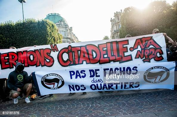 The antifascist activists gathered behind banners on the Republic Square in Lille France on september 24 2016 In response to the opening of the bar...