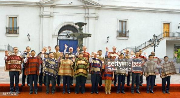The APEC leaders await for the family picture 21 November 2004 at La Moneda Presidential Palace in Santiago From L to R Mexican President Vicente Fox...