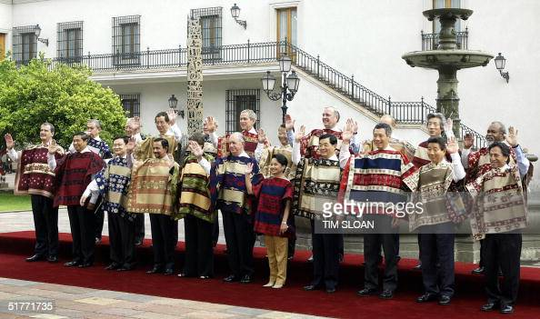 The APEC leaders pose for the family picture 21 November 2004 at La Moneda Presidential Palace in Santiago Chile From L to R Mexican President...