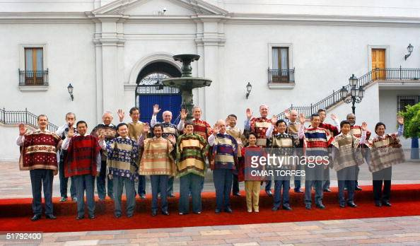 The APEC leaders pose for the family picture 21 November 2004 at La Moneda Presidential Palace in Santiago From L to R Mexican President Vicente Fox...