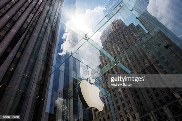 The Aple logo hangs on the Apple Store on Fifth Avenue on August 5 2015 in New York City Analysts at Bank of America Merrill Lynch recently changed...
