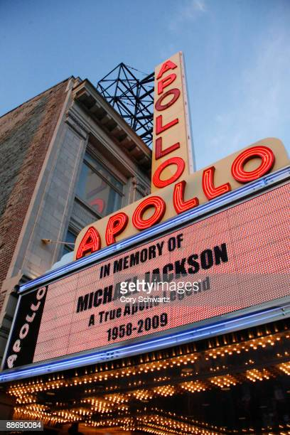 The Apollo Theater's marquee memorializes pop star Michael Jackson as crowds of fans gather outside to remember him on June 25 2009 in New York City...