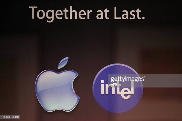 The Apple and Intel logos are seen during a device demonstration event for Thunderbolt a highspeed PC connection technology formerly codenamed Light...