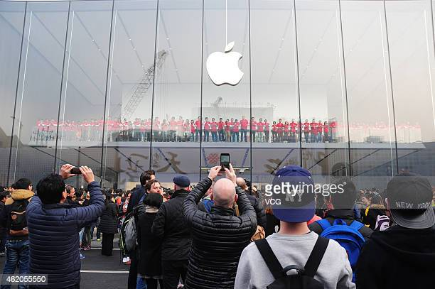 The Apple flagship store opens at Pinghai Road on January 24 2015 in Hangzhou Zhejiang province of China Citizens sales clerks and Apple fans...