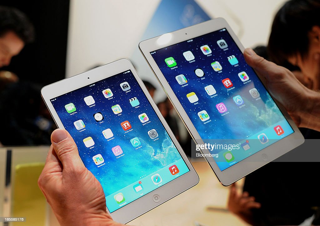 The Apple Inc. iPad Mini, left, and iPad Air are displayed for a photograph during a launch event at the Yerba Buena Center in San Francisco, California, U.S., on Tuesday, Oct. 22, 2013. Apple Inc. introduced new iPads in time for holiday shoppers, as it battles to stay ahead of rivals in the increasingly crowded market for tablet computers. Photographer: Noah Berger/Bloomberg via Getty Images
