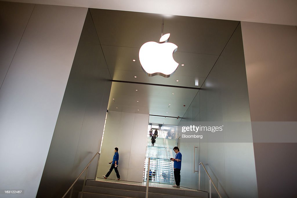 The Apple Inc. logo is displayed at the company's store at Hysan Development Co.'s Hysan Place mall in the Causeway Bay district of Hong Kong, China, on Monday, March 4, 2013. Hysan is scheduled to release earnings on March 6. Photographer: Lam Yik Fei/Bloomberg via Getty Images