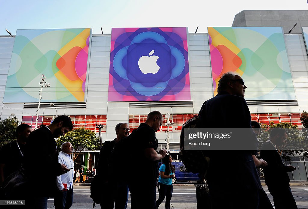 The Apple Inc logo is displayed outside as attendees line up to enter the Moscone Center before the start of the Apple World Wide Developers...