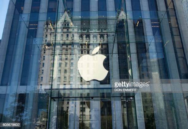 The Apple logo at the entrance to the Fifth Ave Apple store September 14 2016 in New York The iPhone 7 and larger iPhone 7 Plus with sophisticated...