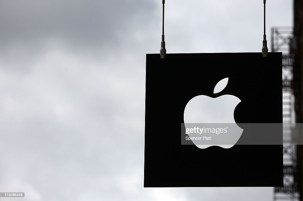 The Apple logo hangs in front of an Apple store on July 23 2013 in New York City Apple is due to report thirdquarter earnings after the markets close...