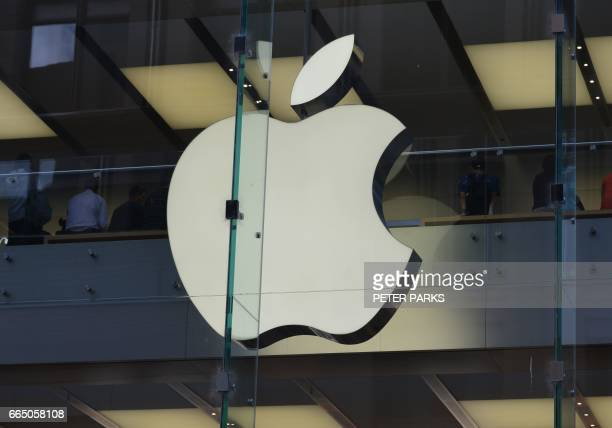 The Apple logo is displayed at a store in the central business district of Sydney on April 6 2017 Apple was on April 6 taken to court by Australia's...