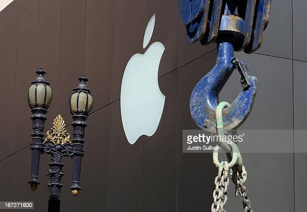 The Apple logo is displayed on the exterior of an Apple Store next to a construction crane n April 23 2013 in San Francisco California Analysts...