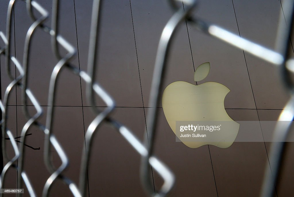 The Apple logo is displayed on the exterior of an Apple Store on January 27, 2014 in San Francisco, California. Apple will report quarterly earnings today after the closing bell.