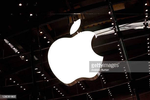 The Apple logo is seen hanging inside the Apple store on West 66th Street on October 5 2011 in New York City Jobs passed away October 5 2011 after a...