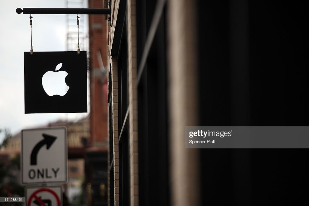 The Apple logo is viewed in front of an Apple store on July 23, 2013 in New York City. Apple is due to report third-quarter earnings after the markets close Tuesday. Apple, the California based technology company, has watched its stock sink to $427.68 a share from an all-time high of $702 last September. The company is under pressure to release a new blockbuster product.