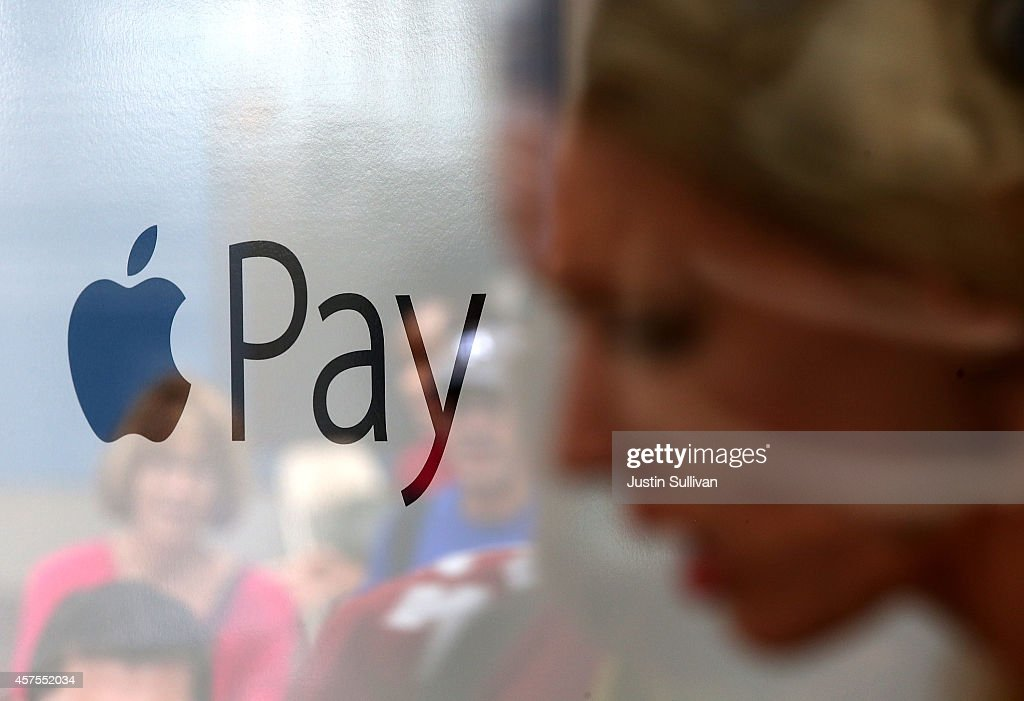 The Apple Pay logo is displayed in a mobile kiosk sponsored by Visa and Wells Fargo to demonstrate the new Apple Pay mobile payment system on October...