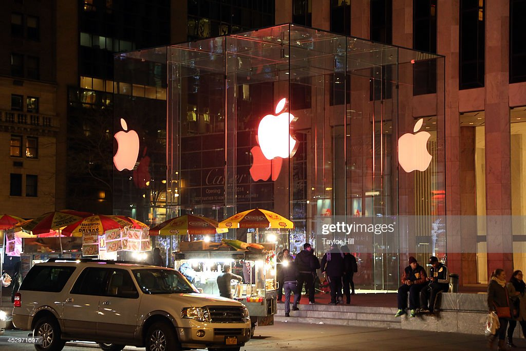 The Apple Store on 5th Avenue as seen during the 25th Annual World AIDS Day on December 1, 2013 in New York City. World AIDS Day is the only day of the year in which the Apple logo is not white in color.