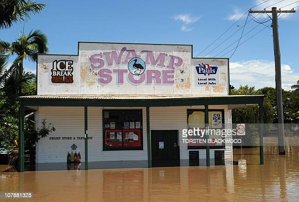 The appropriately named 'Swamp Store' is flooded after the Fitzroy River broke its banks and inundated much of Rockhampton on January 4 2011 Up to...