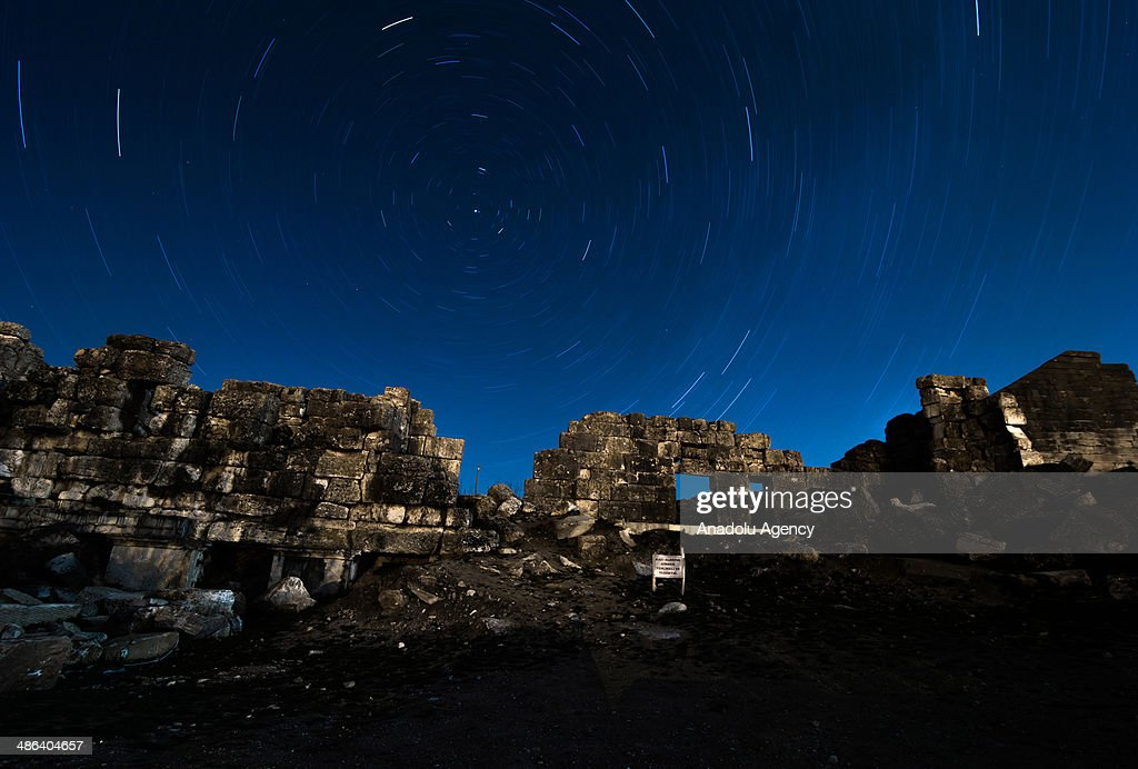 The April Lyrids, a meteor shower lasting from April 16 to April 26 each year, is seen over the ancient city of Aizanoi in Kutahya, Turkey on April 23, 2014. Aizanoi is an ancient city in western Anatolia in Cavdarhisar, Kütahya. The city has a temple built for Zeus which is the best-preserved temple in all of Anatolia, and also has a large theatre, a stadium adjacent to theatre, two Turkish-style baths, a gymnasium, five bridges on Kocacay which are still used today, an old dam, a trading building, and avenues with columns on both sides, necropolis areas and the sacred cave of Metre Steune.