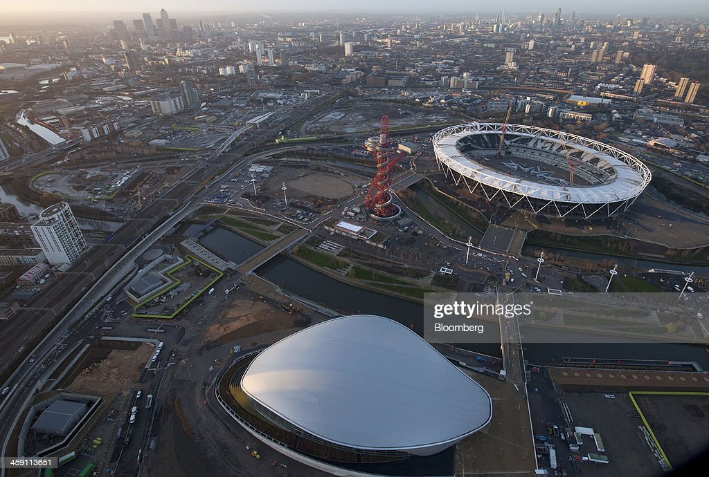 The Aquatics center left and the London 2012 Olympic Stadium right are seen in this aerial photograph looking towards the Canary Wharf business and...