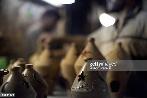 The Arabic expression 'Ramadan Karim' is engraved on a clay lantern left to dry at a workshop in Gaza City on August 17 ahead of the start of the...
