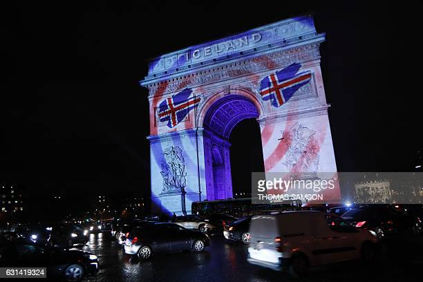 The Arc de Triomphe is illuminated with the colors of the Icelandic flag to launch the 25th World Men's Handball Championship in Paris on January 10...