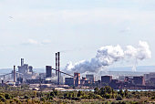 The Arcelor Mittal steel production plant is seen on the horizon on the Mediterranean coast at Fos Sur Mer France on Tuesday Sept 17 2013 Arcelor's...