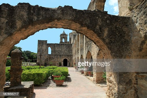 The arch and garden view of Mission San Jose