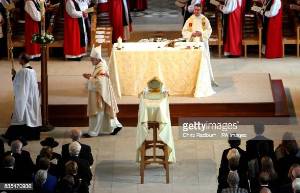The Arch Bishop of Canterbury Rowan Williams [left] files past the coffin of The Bishop of Peterborough The Right Reverend Ian Cundy at Peterborough...