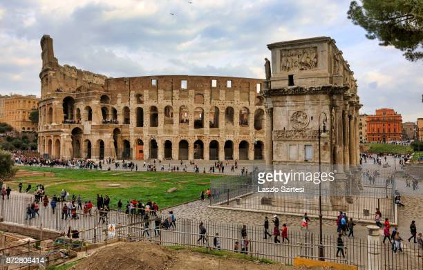 The Arch of Constantine and the Colosseum are seen at the Palatine Hill on October 30 2017 in Rome Italy Rome is one of the most popular tourist...