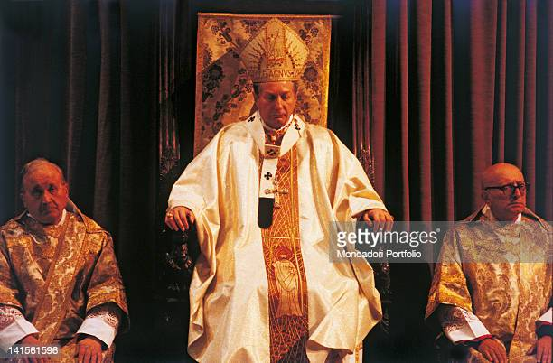 The archbishop Carlo Maria Martini is serving a religious ceremony in the cathedral of his archdiocese Milan the 80s