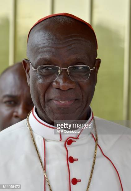The Archbishop of Abidjan Cardinal JeanPierre Kutwa leaves from an audience with Ivory Coast's president Alassane Ouattara at the presidential palace...