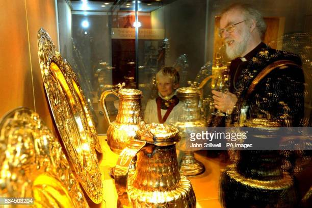The Archbishop of Canterbury Dr Rowan Williams and Joeseph Arnander both study a glass display with some of the exhibits of the 'Treasures of the...