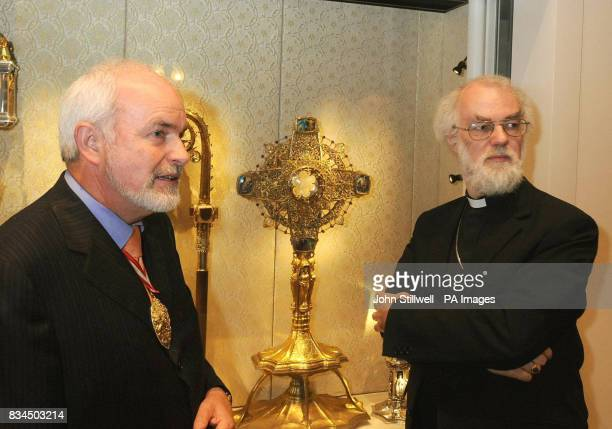 The Archbishop of Canterbury Dr Rowan Williams and the Managing Director of Goldsmiths Grant Macdonald study some of the exhibits of the 'Treasures...