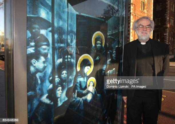 The Archbishop of Canterbury Dr Rowan Williams stands with a Christmas campaign poster at a bus stop on Lambeth Palace Road London