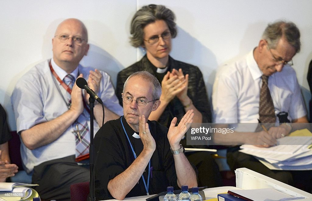 The Archbishop of Canterbury Justin Welby applauds a speaker during the Church of England's Synod session to discuss and vote on the consecration of women bishops on July 14, 2013 in York, England. The Synod contradicted tradition today and voted to give women the right to be bishops of the Church of England.