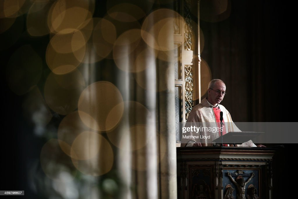 The Archbishop of Canterbury <a gi-track='captionPersonalityLinkClicked' href=/galleries/search?phrase=Justin+Welby&family=editorial&specificpeople=9960447 ng-click='$event.stopPropagation()'>Justin Welby</a> delivers his Christmas Day sermon at Cantebury Cathedral on December 25, 2013 in Canterbury, England. Today marks the Archbishop's first Christmas since being enthroned in the position.