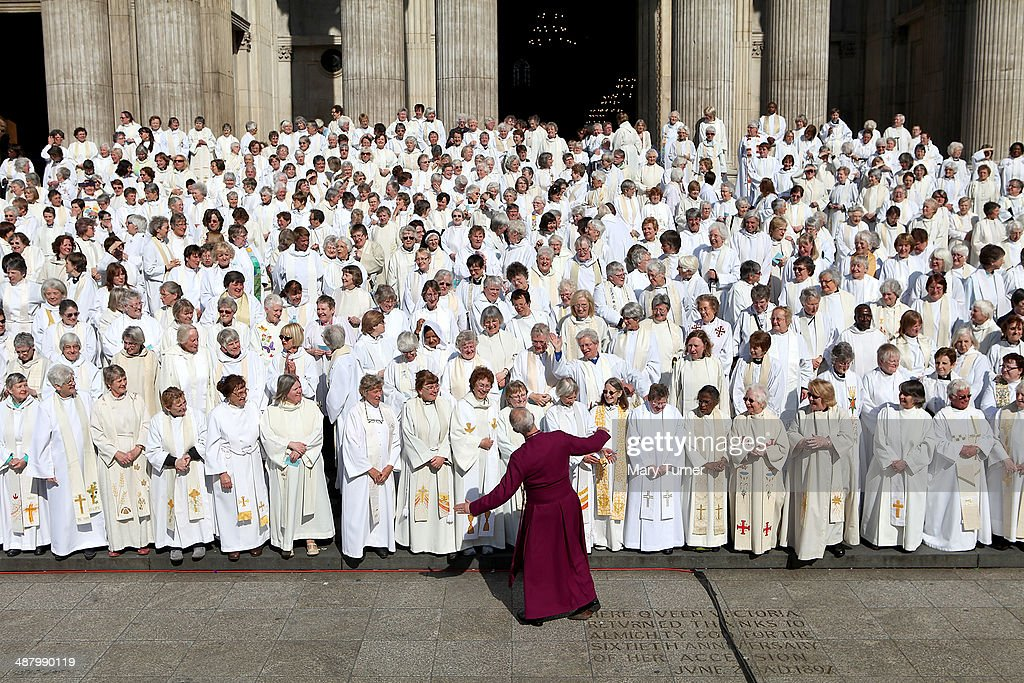 The Archbishop of Canterbury Justin Welby jokes with a crowd of hundreds of women priests who posed on the steps of St Paul's Cathedral before going...