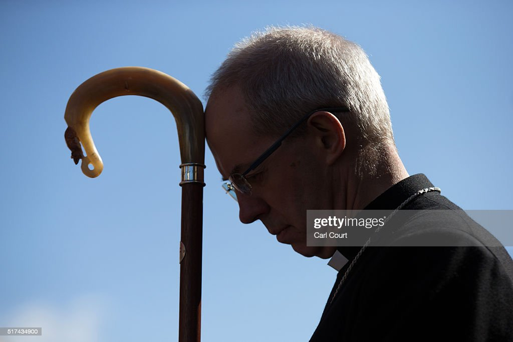 The Arch-Bishop of Canterbury listens to a service after a March of Witness through the town centre on March 25, 2016 in Sittingbourne, England. Christians around the world have observed religious services to mark Good Friday. The holiday is observed during Holy Week as part of the Paschal Triduum on the Friday preceding Easter Sunday.