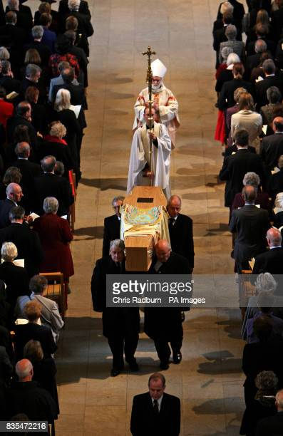 The Archbishop of Canterbury Rowan Williams follows the coffin of The Bishop of Peterborough The Right Reverend Ian Cundy as it leaves Peterborough...