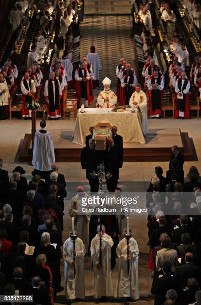 The Archbishop of Canterbury Rowan Williams looks on as the coffin of The Bishop of Peterborough The Right Reverend Ian Cundy is carried from his...